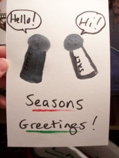 A card with a salt and pepper shaker saying hello with the text seasons greetings.